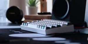 Anne pro mechanical keyboard sitting on a desk mat.