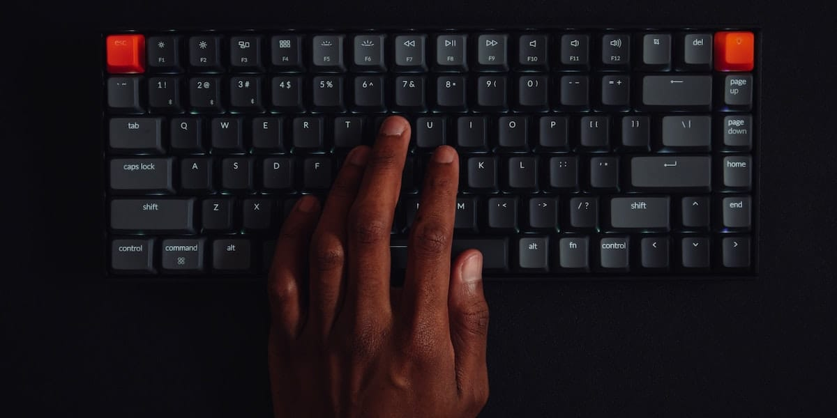 Person typing on a mechanical keyboard.